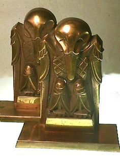 Stylized Art Deco Bronze Raven Book Ends c 1935 Item #1452  If you like the rare and unusual decorative items this set is for you.  Wonderful patina on the bronze...very heavy and designed by a real talent.  They are a little over 6 inches tall and are about 5 1/4 inches at the base...and  about 2 1/2 inches deep.