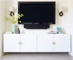 a chic floating media console made of an IKEA Besta piece and stylish round pulls hacks living room media consoles Floating Media Console, Wall Mounted Media Console, Ikea Tv Console, Tv Wall Shelves, Shelf, Wall Mount Entertainment Center, Kids Room Furniture, Tv Storage, Hemnes