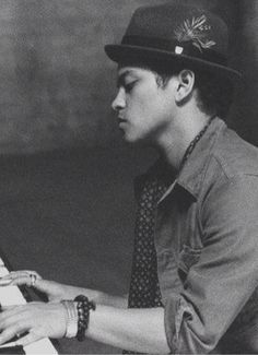Bruno Mars..after seeing him perform last night on the vmas i really wanna see him in concert now