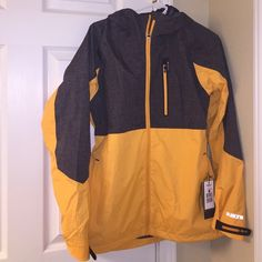 NWT Burton Jacket WB Berkley JKT Phantom Jacket, waterproof/ breathable membrane, coated with DWR finish. Price negotiable. Looks yellow in pictures, but it is orange. Nike Jackets & Coats