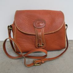Vintage Dooney and Bourke Brown Pebbled Leather Crossbody Satchel Purse/Bag. $55.00, via Etsy by MothEatenDeerHead.