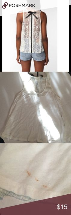 Urban outfitters white tank top Lace back, cotton front. Flaw in third pic. Have not tried to remove Urban Outfitters Tops
