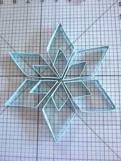 Paper snowflake tutorial- could also use toilet paper and paper towel rolls!