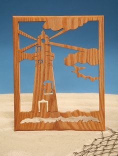 Download this free lighthouse silhouette scroll saw pattern.