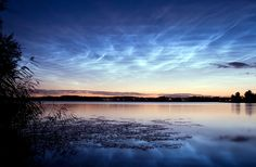 Noctilucent clouds over a lake in Sweden by P-M Hedén