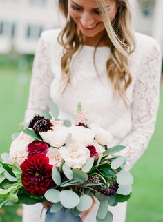 Carnation, rose and eucalyptus bold wedding bouquet: http://www.stylemepretty.com/minnesota-weddings/minneapolis/2017/01/25/a-tale-of-love-and-the-most-stunning-backless-dress/ Photography: Amanda Nippoldt - http://www.amandanippoldt.com/