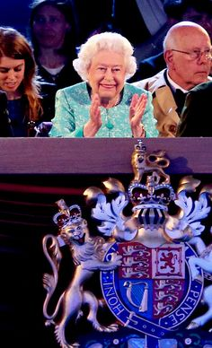 royalwatcher:  Queen Elizabeth's 90th Birthday Celebrations, Great Windsor Horse Show, May 15, 2016-Queen Elizabeth smiles at the show (with granddaughter Princess Beatrice and niece Lady Sarah Chatto and Prince Philip's nephew Prince Ludwig of Baden behind her)