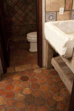 Bathroom with reclaimed terracotta flooring