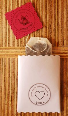 maybe a personalized set of tea bags...for a favor?  .