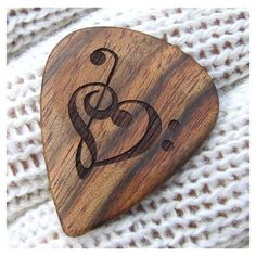 Wood Guitar Pick Handmade Custom Engraved Exotic Wood Guitar Pick... ❤ liked on Polyvore featuring music, instruments, backgrounds, art and guitars