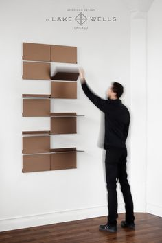 Riveli Shelving (Luxe Series) is a modular shelving system comprised of individual pivoting aluminum shelves that create a wall-mounted, easy-to-install system. Shelving configurations can change in an instant to disp. Modular Walls, Modular Shelving, Modular Storage, Shelving Systems, Modular Furniture, Design Furniture, Furniture Layout, Home Office Furniture, Farmhouse Furniture