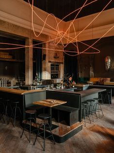 Gastronomy, Mixology and Art Meet in Berlin's KINK Bar & Restaurant | Yatzer Neon Lighting, Interior Lighting, Olafur Eliasson, Industrial Interiors, Industrial Restaurant Design, Cafe Interiors, Restaurant Interiors, Restaurant Interior Design, Blue Curtains