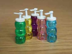 1/12th scale for your dollshouse. Ready to go by the sink, A tall Salon-size 'bottle' with pump top. Colours vary, Price is for ONE bottle only