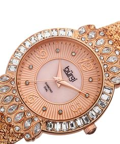 Bürgi Rose Goldtone Diamond & Mother-of-Pearl Bracelet Watch | zulily  .$74.99 $525.00  .Description:  A glamorous take on the classic bracelet watch, this sparkling timepiece features a crystal-encrusted bezel and a mother-of-pearl face with diamond indices.      Case: 38 mm diameter     Bracelet: 17 mm W x 7.5'' L         Face: mother-of-pearl / diamond     Carat: 0.04 tw     Bezel: crystal     Japanese quartz movement     2-year limited warranty Imported