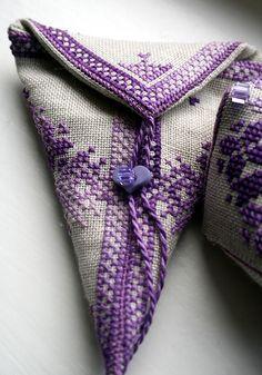 purple cross stitched scissors case