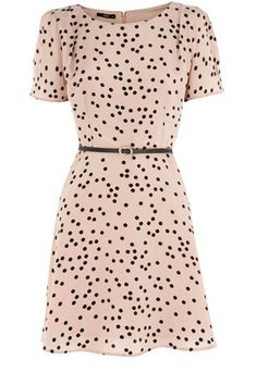 This gorgeous skater dress features an all over spot print. Simply zipping up on the back with a round neckline, short sleeves and complimenting belt. The perfect dress to take you from day to night.