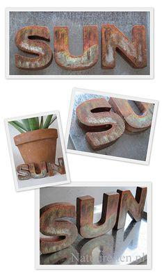houten letters verroest met verf