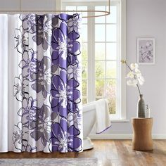 "The Allison shower curtain can brighten up your space in seconds! Its oversized floral motif is emphasized by a vibrant purple and grey color palette. This 72x72"" curtain is made from a polyester microfiber fabrication for easy care."