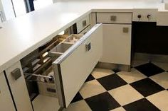 View of refrigerator drawer, pulled open below worktop height with chilled food items inside. The drawer is lit by an interior lamp when ope. Fridge Drawers, White Laminate, Corian, Kitchen Design, Kitchen Cabinets, Appliances, Food Items, Refrigerator, Interior