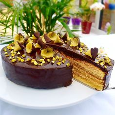 Layer Cake/Baumkuchen - layers of cake,laced with rum and pistachio marzipan and topped with chocolate ganache. Find the recipe on my website.