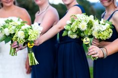 Bouquets of white dahlias, mini green hydrangea, green parrot tulips, white freesia, and hilarious buttons!
