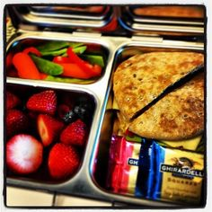 Tasty Thursday: @Planet Box lunch contains a veggie sandwich on a wheat sandwich thin with hummus and cheese, mixed berries, carrots, snap peas, and sweet red pepper rings, and two Ghiridelli chocolatesa dark chocolate sea salt caramel and a dark chocolate raspberry #yum #planetbox #lunch #bento #organized #vegetarian by @Jaclyn Sullivan