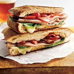 Mozzarella, Ham, and Basil Panini - From Cooking Light A few special ingredients--like freshly baked ciabatta bread or imported Dijon mustard--make a quick, simple sandwich seem like a treat. Sandwiches, Lunch Recipes, Cooking Recipes, Basil Recipes, Cooking Tips, Leftover Ham Recipes, Good Food, Yummy Food, Delicious Recipes