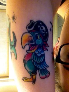 Cute Parrot tattoo. Pirate Parrot. Work done by Sean Hutson at Sailors Grave San Diego.  Healed with Whipped Tattoo Cream