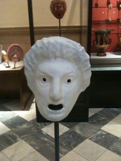 In a wide open theatre, masks like these were designed to bring the character's face closer to the audience through the exaggerated facial features and expressions.  This way a single actor could play many roles, without being identified with one character.  Specific masks were created for specific events or characters in plays. For example, the mask for Oedipus before he was blinded would be different from the mask after he was blinded.