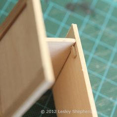 How To Make Working Base Cabinets for a Dollhouse Kitchen: Add a Door Stop To the Interior of the Dollhouse Kitchen Cabinet