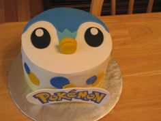 Pokemon Piplup Piplup cake , iced in buttercream with fondant decorations - the POKEMON is printed then placed on gumpaste.