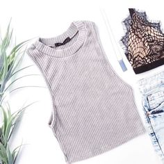 Ribbed crop top Ribbed crop top in mineral washed gray color. Soft, stretchy, lightweight material. Modeled photos courtesy of April Spirit.   Fabric content: 61% polyester, 33% rayon, 6% spandex Fit: Juniors  Model wearing size S  •Price is firm• April Spirit Tops Crop Tops