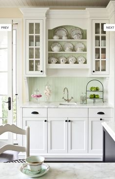 Wet bar with lovely open shelving & detailed cabinets