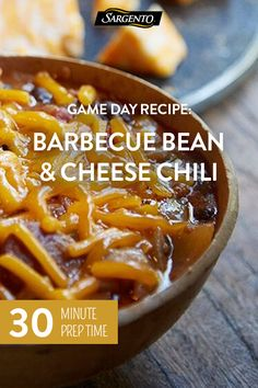 Promoted by Sargento®. Warm up for the big game with this easy-to-master Barbecue Bean & Cheese Chili recipe. This smoky dish takes 40 minutes to prepare but tastes like it's been simmering all day. Top with Cheddar cheese and bacon bits for the ultimate power play. Click through for the full recipe!