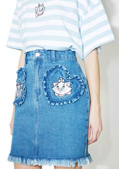 Lazy Oaf X Disney Aristocats Denim Skirt is purr-fectly appealing. This darling skirt features a classic denim construction with relaxed slim fit, dual heart shaped front pockets with adorbz embroidered Marie the cat patches and a playful frayed hemline, complete with a zipper fly button closure.