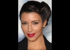"2009  For the Los Angeles premiere of ""Whiteout,"" Kim does rockabilly glam with a rolled updo and bright red-pink lips."