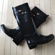 NWT Coach Tall Rainboots - shiny black NWT Coach Tall Rainboots - shiny black w/gold accents. Size 6 (36 EUR) Coach Shoes Winter & Rain Boots