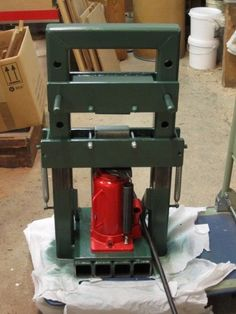 Mini Hydraulic Press by Eastvillage -- Homemade mini hydraulic press fabricated from steel and powered by a bottle jack. http://www.homemadetools.net/homemade-mini-hydraulic-press-12