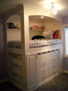 bed with storage below. Great idea!