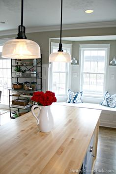 Kitchen island close-up featuring the Progress Lighting Archie pendants. Decor, Kitchen Island, Renovation Design, Chic Kitchen, Home, Kitchen Island Lighting, Rustic Flooring, Decorating Your Home, Rustic House
