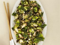 Fried Brussels Sprouts with Walnuts and Capers recipe from Michael Symon via Food Network