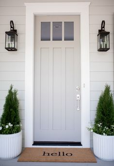 grey exterior house colors Come see why Sherwin Williams Dorian Gray is one of my favorite gray paint colors for just about any space in your home! A true, warm, gray paint. Painted Exterior Doors, Exterior Gray Paint, Exterior Paint Colors For House, Painted Front Doors, Paint Colors For Home, Gray Exterior Houses, Outside House Paint Colors, Exterior House Lights, Bungalow Exterior