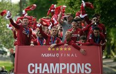 The players wave their flags as they drive to see the thousands of fans for the victory parade. They became six-time European champions with goals from Mohamed Salah and Divock Origi to beat Tottenham Liverpool Champions, Liverpool Players, Liverpool Football Club, Liverpool Fc, Champions League, Salah Liverpool, Victory Parade, Best Football Team, Premier League