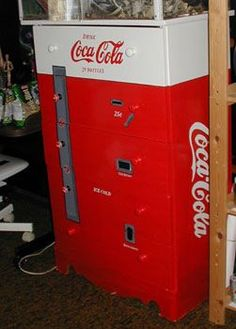 HAVE to do this!!!!!!  This is a dresser painted to look just like an antique Coca-Cola machine!