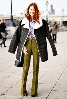 Taylor Tomasi Hill wears a floral button-down, shearling-lined plaid coat, wool skinny trousers, and black boots