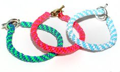 using landyard plasticy string you can create an awesome bracelet you need string, fastener, basically all pieces are shown in the image