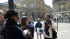 American expat tour guide Monique Y. Wells leads a tour in Paris.  As a couple, Monique and her husband also blog and write newsletters and books on exploring Paris--recommended.  See:  DiscoverParis.net