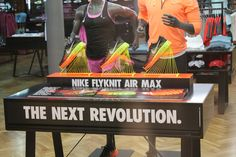 Nike Flyknit - Air Max retail table display sports in-store shoe display with string.
