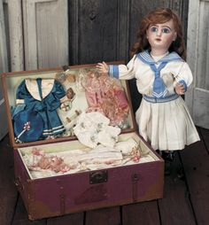 French Presentation Trunk with Bisque Doll and Three Complete Costumes circa 1900s ~ sold $2400.