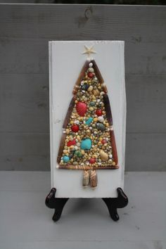 Hey, I found this really awesome Etsy listing at https://www.etsy.com/listing/112253572/seashell-christmas-tree-on-reclaimed